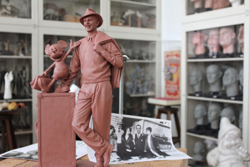 "disneylandiaobscura:  New statue concept model for Buena Vista Street in DCA. While I really like the design and style, this worries me a bit: ""He is located on the ground, not on a pedestal or planter, so that he is accessable to guests – ""one of us."" Quote from Disney Parks blog. While not Disney's fault, if the statue isn't somehow blocked off or in a planter, I expect we'll be seeing a lot of jokey/bad taste photos with Walt here…I hope they thought that through in advance. CM's watching and telling people not to take photos of in poor taste things wouldn't go over well either."