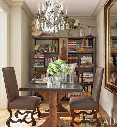 Antique French chairs from Michael Trapp flank a wood- and-zinc table from R.T. Facts.