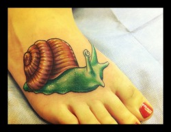 "fuckyeahtattoos:  My snail was inspired by the song 'Snails' by The Format. ""snails see the benefits, the beauty in every inch.' I got this to remind myself to slow down and see the beauty in my life. It was done by Jason Begay at Stand Alone Tattoo in Phoenix, Arizona."