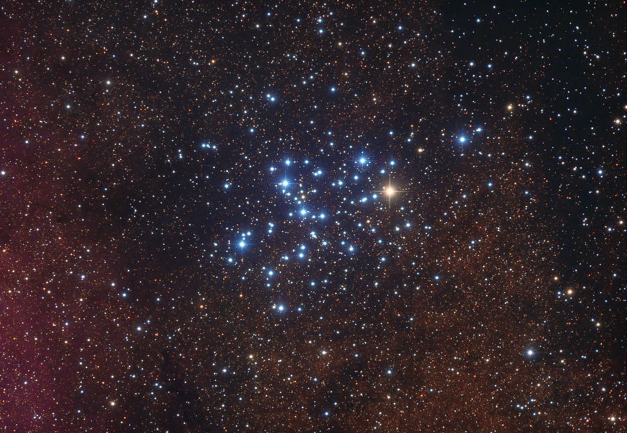 M6: The Butterfly Cluster Explanation: To some, the outline of the open cluster of stars M6 resembles a butterfly. M6, also known as NGC 6405, spans about 20 light-years and lies about 2,000 light years distant. M6 can best be seen in a dark sky with binoculars towards the constellation of Scorpius, coving about as much of the sky as the full moon. Like other open clusters, M6 is composed predominantly of young blue stars, although the brightest star is nearly orange. M6 is estimated to be about 100 million years old. Determining the distance to clusters like M6 helps astronomers calibrate the distance scale of the universe. Image Credit & Copyright: Sergio Eguivar Buenos Aires Skies