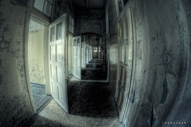Corridor of fear. A long creepy corridor in one of the buildings at abandoned lunatic asylum TZ in Germany.