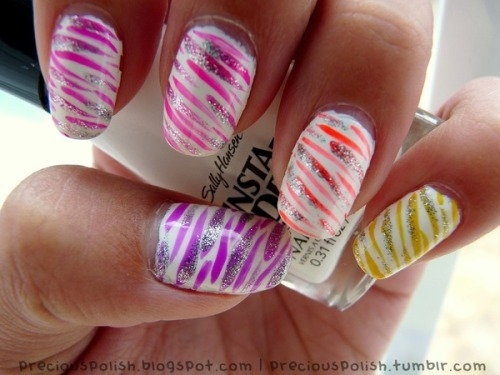 Check out Beautylish Beauty Brittney W.'s fun neon zebra print nails! Check out this nail tutorial to get stripes of your own!
