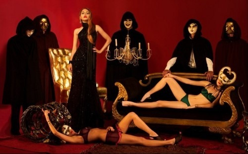 Brittany Murphy surrounded by masked individuals in a occult ritualistic setting taken shortly before her death