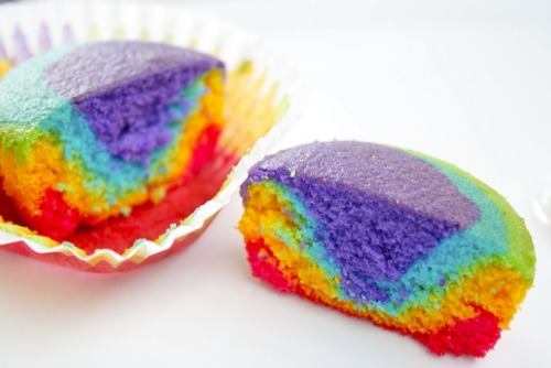 These rainbow cupcakes look amazing. Me and a friend once made a 5-layer rainbow cake for the 21st birthday of another, covered in glitter, frosting and love-heart candy. Each layer was a different pastel shade, but we weren't brave enough to attempt a same-cake rainbow like this! Maybe one day…