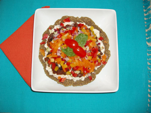 Here's a raw pizza I made for my hubby.  I created the recipe for our new vegan raw & cooked whole food cookbook.