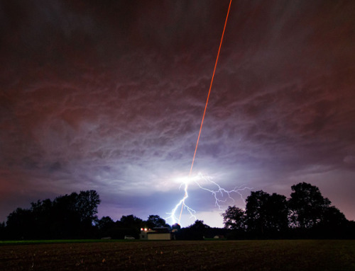 "jtotheizzoe:  Humans fire laser to sky, sky laughs, responds with lightning (They were actually firing a kind of ""guide star"" that is used to target and correct ground-based telescopes when this shot happened. Nature is still not impressed) (via Short Sharp Science)"