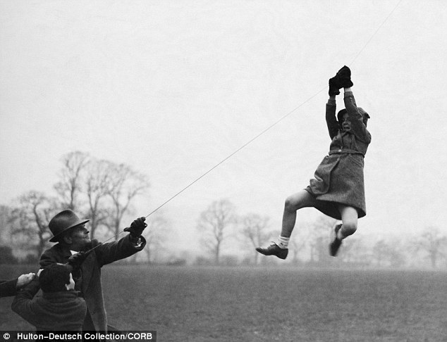 blackandwtf:  1930s A young girl in London hangs on to the string of a kite. (via Mail Online)