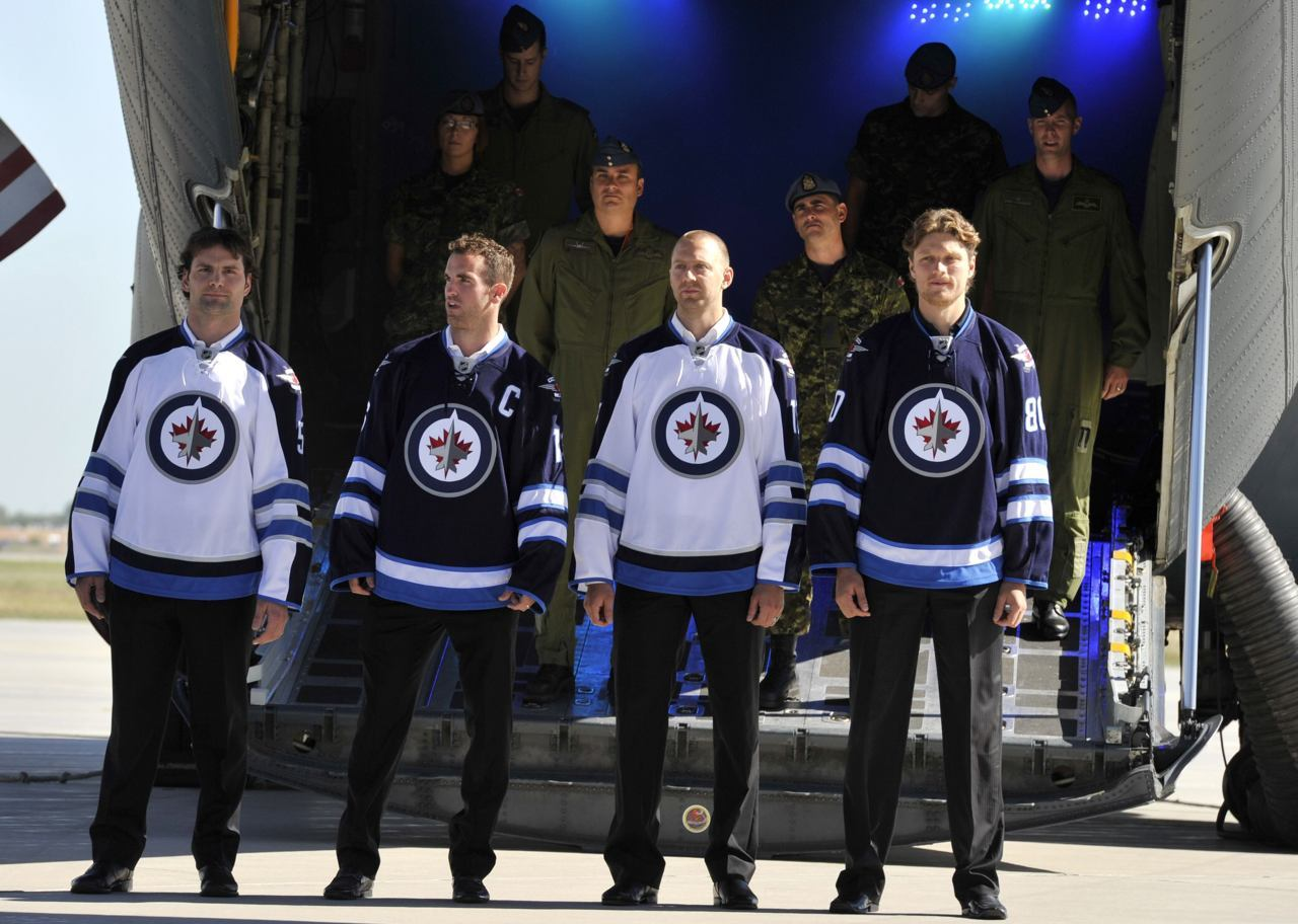 nationalpostsports:  Finally… the new Winnipeg Jets jerseys have been unveiled. (Photo: Fred Greenslade/Reuters)