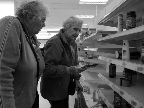 Betty and Doris empty the shelves.