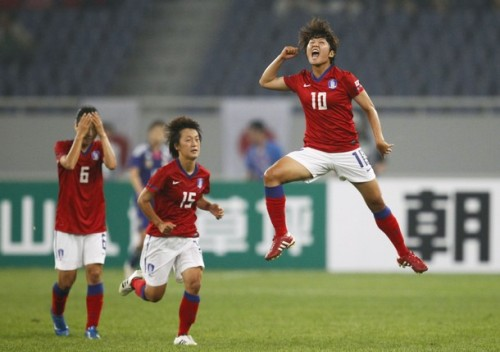 South Korea's Ji So-yun (R) celebrates beside her team-mates Ryu Ji-Eun (L) and Kwon Eun-Som (C) during their women's soccer qualifying match for the 2012 Olympic Games against Japan, in Jinan, Shandong province September 3, 2011. (via Photo from Reuters Pictures)