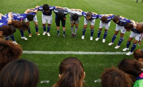 Japan's team members huddle together before their match against Thailand during the women's qualifying soccer tournament for the 2012 Olympic Games in Jinan, Shandong province September 1, 2011. (via Photo from Reuters Pictures)