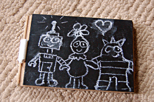 skillzmcfly:  I made a cute little chalkboard for Evie yesterday! The chalkboard was made out of a flooring sample from Home Depot! Check it out:  They have a ton of samples in the flooring section and they have a bunch of linoleum samples cut into perfect squares too, for anyone who wants to do some linoleum printing. I just painted it with Martha Stewart's chalkboard paint (which I got for $3, thank you Michael's for the 50% off coupon!) and viola! Tiny chalkboard for Evie! Now she can stop asking to play with my vintage one hanging on the wall. The edges of some of the samples even have grooves where the flooring is supposed to fit together where you can store your chalk!  After I took the picture I realized Evie didn't have an eraser so I made of one those too. I just took a small rectangular piece of foam that I had laying around, glued felt to one side and a piece of cardboard painted black to the other. She just LOVES it! As you can see, she keeps making me draw Yo Gabba Gabba guys, specifically the stuffed ones she has and loves the best. (Omg, stuffed Plex is her best friend until forever.) This couldn't have been easier, and I'm sure there's a ton of other things you could add to it, maybe for a teacher's gift? (I just thought of that right now and I'm so excited! Too bad Evie isn't in school yet!) The whole project cost me the price of the paint! The flooring sample was free, I had chalk and enough scraps to make the eraser. Three bucks! You can't beat that.