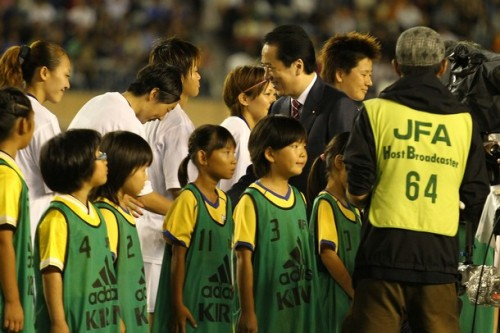 Prime Minister Naoto Kan and Kyoko Yano of Japan shake hands piror to kick off of the Women's Olympic Soccer Asian Qualifier Send Off match between Japan and Nadeshiko League XI at the National Stadium on August 19, 2011 in Tokyo, Japan. (via Photo from Getty Images)