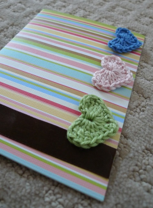 Striped birthday card adorned with three dainty crocheted hearts.  Learn how to make them here.