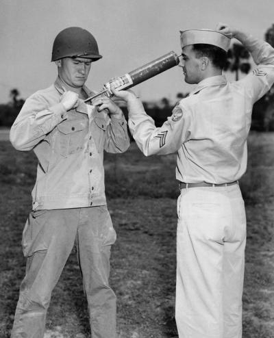 WWII - A U.S. soldier demonstrating DDT-hand spraying equipment while applying the insecticide.  De-lousing both soldiers and POW to get rid of body lice was critical in controlling the spread of typhus. Transmitted by the body louse, typhus has a nasty reputation of killing even more soldiers than combat during wars prior to the invention of DDT.