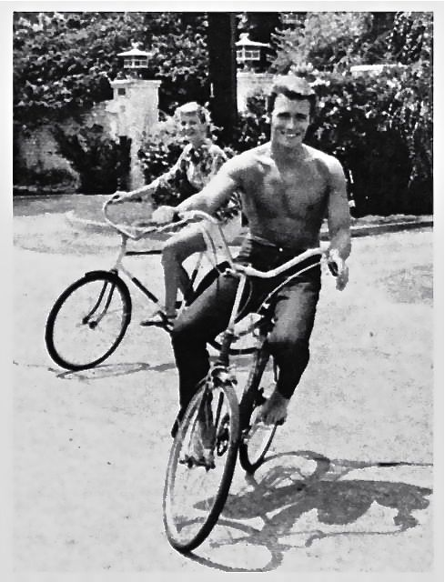 Clint Eastwood rides a bike.