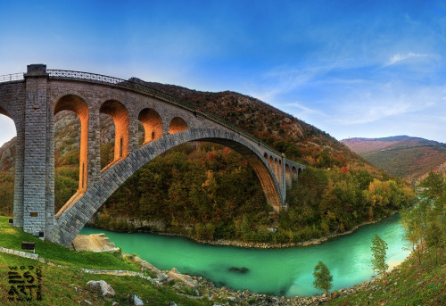 dazzlingagony:  Solkan Bridge is a 220-metre long stone bridge over the river Soča near Nova Gorica in western Slovenia. With an arch span of 85 metres it is the second longest stone arch in the world and the longest stone arch among train bridges. It was built between 1900 and 1906.