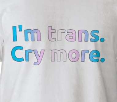 Image of a white t-shirt with text in the trans pride flag colors, reading: I'm trans. Cry more.