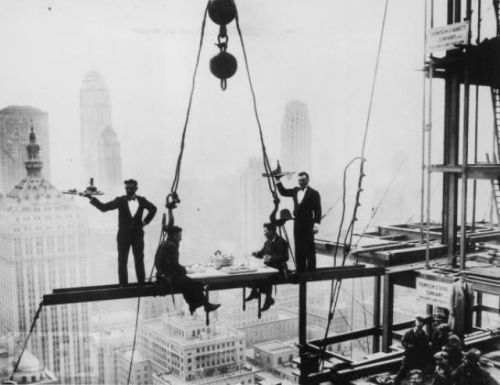 mothgirlwings:  Waiters serve two for lunch on a steel girder high above New York City - 1930