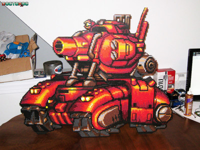 it8bit:  Metal Slug Big Red Tank Bead Sprite  Created by Levi Buffman Artist note: A layered bead sprite of the big red tank from Metal Slug. Contains 15,860 beads among 60 pieces on 13 layers.