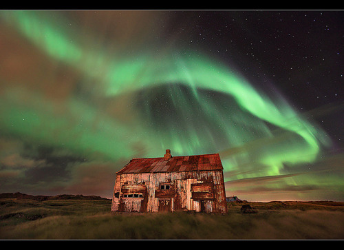 flaneur-etrange:  Aurora over Rusty Shack - Hafnarfjörður, Iceland by orvaratli on Flickr.   Northern Lights