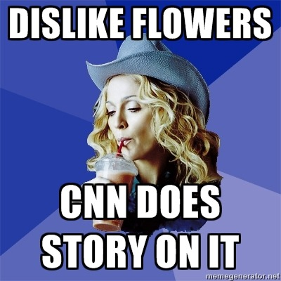 madonnaciccone:  Who else gets on the news for disliking a flower? Only Madonna… Click here to watch!  Everyone online is buzzing about this, saying how rude she was, but in actuality, I don't think it was remotely rude, whatsoever. She happily accepted the flowers with a smile on her face and said thank you, and there is not one person on this planet who can honestly say they wouldn't turn to their friends and make a comment if they were flowers you did not like, or make some sort of comment later on. She just had the misfortune being videotaped. Get your heads out of your asses like you're better than Madonna.