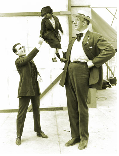 Date unknown Harold Lloyd shakes hands with a little person. (via holmes guy)
