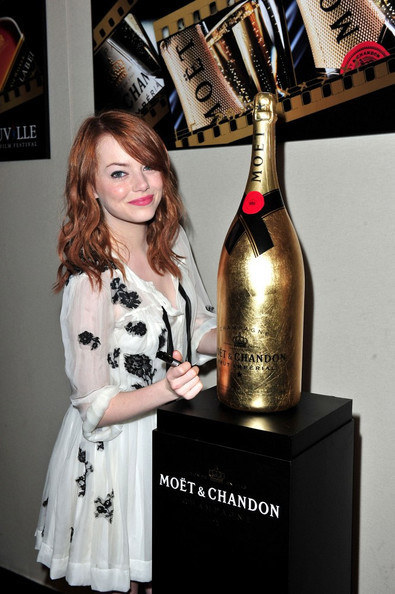 styleite:  We love Emma AND champagne. dolcegabbana:  Emma Stone wearing a Dolce & Gabbana Dress at 'The Help' photocall at the 37th Annual Deauville American Film Festival on September 3rd, 2011