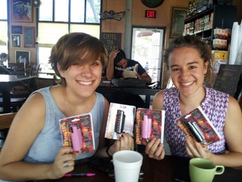 TexFem officers Jenny Kutner and Brianna Guidorzi receiving free pepper sprays from Resist Attack
