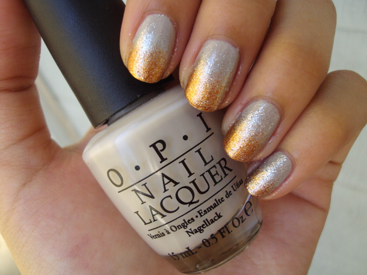 stephanieanguyen:  Metallics Gradient OPI's Skull & Glossbones (as a base), DS Radiance, Rising Star, and then one coat of China Glaze's Silver Lining over everything! Ta da!