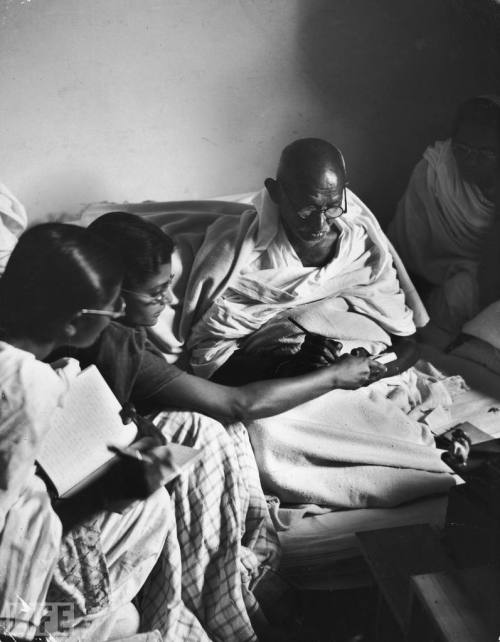 Gandhi: Glimpses of a Legend  In a career spanning more than two decades, photographer Margaret  Bourke-White fearlessly documented many facets of the human experience. Her astonishing portfolio ranged from trailblazing assignments in the  Soviet Union in the late 1920s, to capturing the horrors of the  Buchenwald concentration camp upon its liberation in 1945. And  Bourke-White's focus on humanitarian issues — showcased in these  stunning images of Mohandas Gandhi in India — was equally renowned.  Pictured: In 1946, the iconic leader sits next to a spinning wheel, a  device used to make yarn or thread; the image came to symbolize Indian  self sufficiency — and thus independence from British rule.