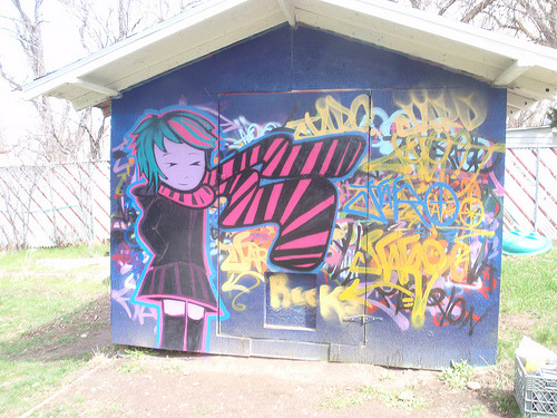 Daily Graffiti: Chau, Knives Knives Chau from the Scott Pilgrim graphic novels adorns a shed. Pic by aniriestate. Check out the DAILY GRAFFITI ARCHIVES for more geektastic street art!