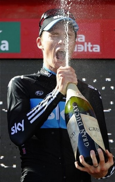 fuckyeahcycling:  Vuelta a Espana 2011 | Stage 17 (via Photo from AP Photo)  Another naughty podium champagne shot. keep them coming, boys.