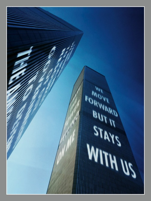 """We move forward but it stays with us."" These aren't Jenny Holzer's words, but she's the artist who molded them into a visual titan. This photo-illustration, now the back cover of our ""Beyond 9/11"" Special Commemorative Issue, is Holzer's rendering of the significance of 9/11, done in her signature style. What we see are these words transposed onto towers that fell 10 years ago.  The phrasing actually belongs to Howard Lutnik, the CEO of Cantor Fitzgerald, the company whose offices took up the 101 to the 105 floors of the World Trade Center's north tower. Lutnik took the morning off from work on Sept. 11, 2001 to take his son Kyle to his first day of kindergarten, and was interviewed about that day (along with his son, now a freshman in high school) as a part of our ""Beyond 9/11"" project.  After graduating from the Rhode Island School of Design in the late 1970s, Holzer began coining her artistic trademark by writing short slogans in public places. ""If you want to reach a general audience,"" she told TIME in 1990, ""it's not art issues that are going to compel them to stop on their way to lunch, it has to be life issues."" She went on to project her ""truisms"" onto famous cityscapes all over the world. ""Beyond 9/11"" began as a series of portraits of the 40 men and women whose lives are forever tethered to that day, but we quickly realized that their words held as much power as their images. Executive editor Radhika Jones says Holzer's work is ""a beautiful marriage"" between the artistic vision of this issue and the significance of the words behind them. Now, her 9/11 back cover image, wrapped in silver, sits next to Julian LaVerdiere and Paul Myoda's ""Tribute in Light Years,"" a tribute to the buildings that are lost to us now."
