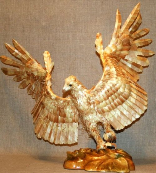 "archiemcphee:  This magnificent eagle was created by Russian artist Sergey Bobkov, who specializes in making animals using wood chips cut from Siberian cedar.  ""Bobkov, who received a patent on manufacturing art sculptures made of cutting chips, has made a total of 15 life-size wooden sculptures of Siberian birds and animals. The artist is known to study an animal's anatomy and habits before creating these one-of-a-kind sculptures.""  Visit My Modern Metropolis to view more of Sergey Bobkov's wonderful wooden creatures."