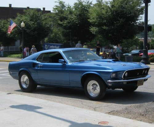 everysainthasapast:  This is my dad's Mustang it's a 1969 Mach 1 He got it when he was 17, and has since completely restored it, it's now a show car (with the occasional pass at the drag strip!).   I grew up around cars, and going to car shows, I love it.