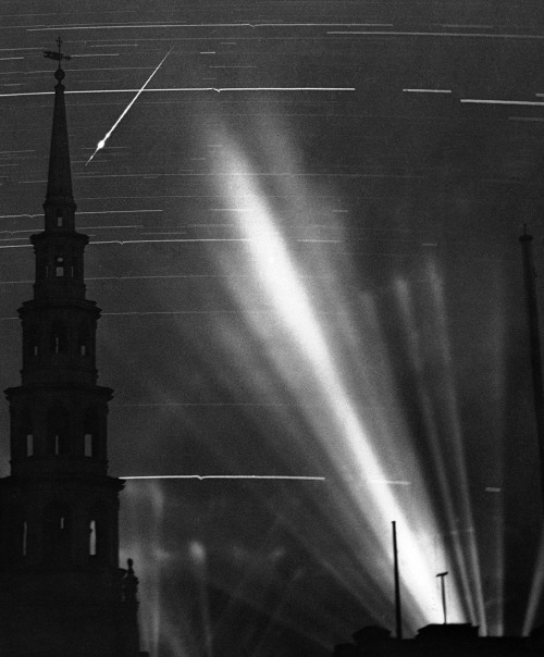 sisterspock:  A ninety minute exposure taken from a Fleet Street rooftop during an air raid in London, on September 2, 1940. The searchlight beams on the right had picked up an enemy raider; The horizontal marks across the image are from stars and the small wiggles in them were caused by the concussions of anti-aircraft fire vibrating the camera; The German pilot released a flare, which left a streak across the top left, behind the steeple of St. Bride's Church.