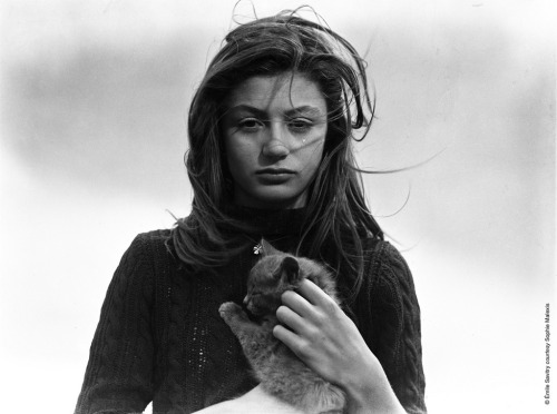 with her cat Tulip Flower.  paperspots:  Anouk Aimee
