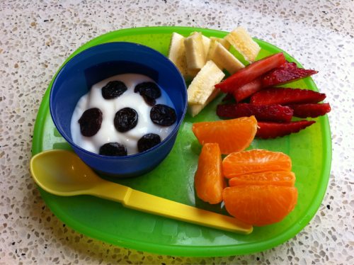 Fun Snack-Vanilla & honey yoghurt topped with dried cherries-Mandarins, strawberries & banana for dipping