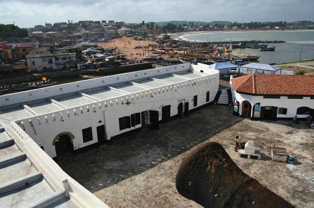 Historic Ghana: The African-American ConnectionCourtyard of the slave castle at Elmina, Central  Region. Well behaved slaves get the rare opportunity of seeing the light of day by exercising here in heavy chains.