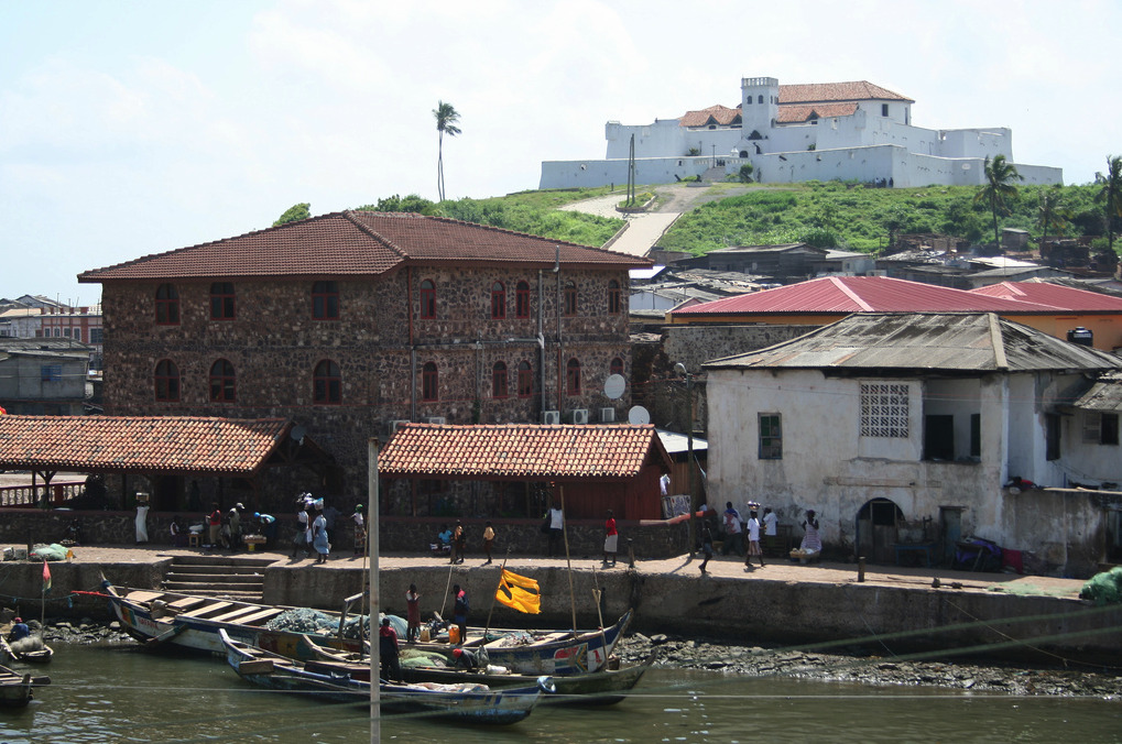 Historic Ghana: The African-American ConnectionSlave castle at Elmina, Central  Region. Surrounding town at the foot of the hill.