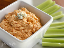 "Lighter Buffalo Chicken Dip  Gina's Weight Watcher Recipes 4 oz reduced fat cream cheese, softened 1 cup fat free sour cream (or plain nonfat yogurt/Greek yogurt) 1/2 cup Franks hot sauce (or whatever hot sauce you like) 1/2 cup crumbled blue cheese 1 tsp white wine vinegar 2 cups (2 breasts) cooked shredded chicken (yes, you can use vegan ""chicken"") Mix the first 5 ingredients together until smooth.  Add the chicken and put this in the crock pot on low for 3-4 hours.  Serve warm. Makes 5 1/2 cups. Makes nine 1/2 cup servings at 108 Calories each  Fat: 4.9g / Carbs: 5.4g (Fiber: 0g)/ Protein: 10.3 g"