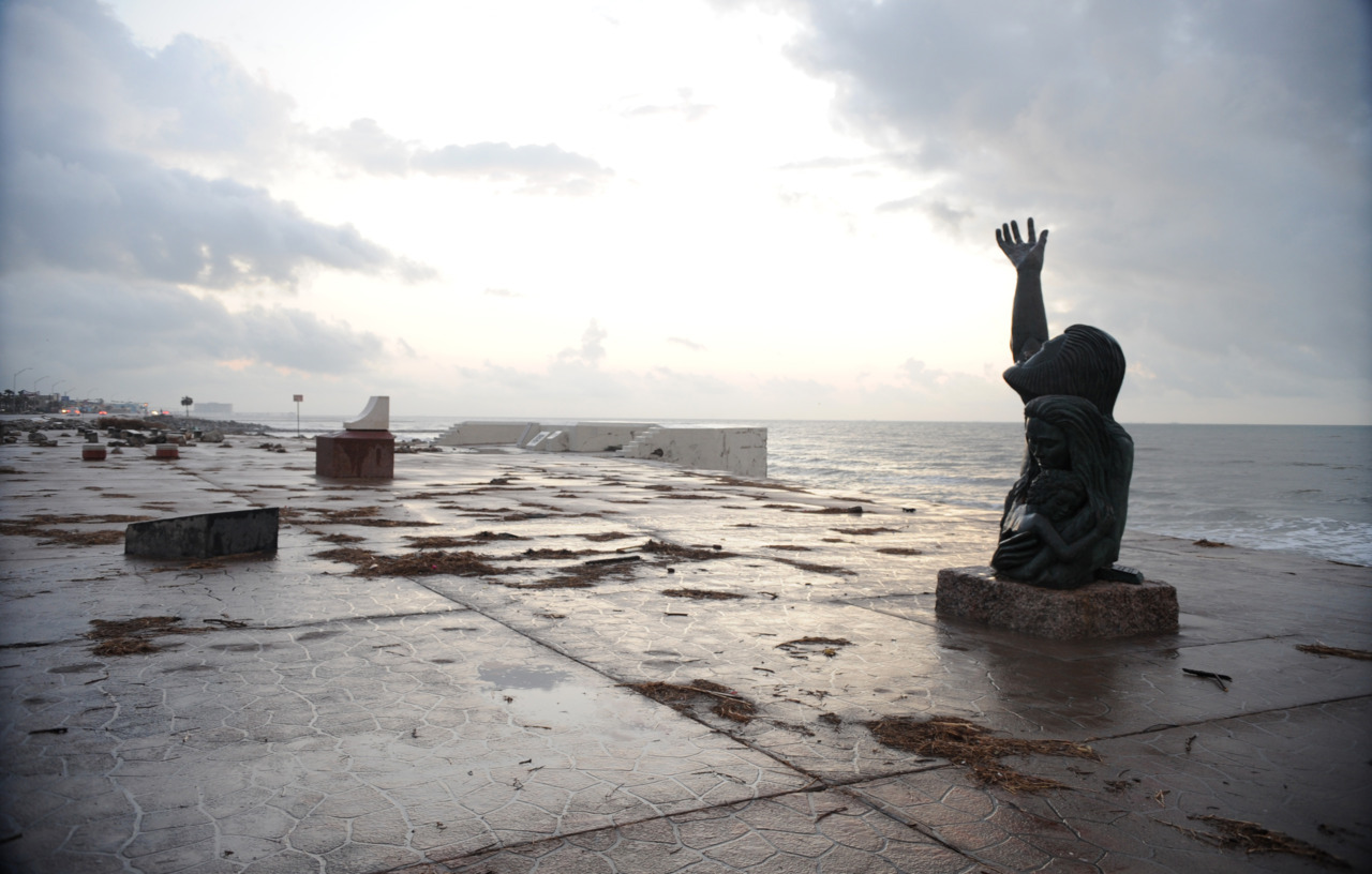 "A statue in memory of the victims lost at sea during the Galveston hurricane of September 8, 1900, ""Place of Remembrance"", the work represents the suffering of the victims and the strength of the survivors who stayed to rebuild the city, Hurricane Ike just passed through the community. Jocelyn Augusitno/FEMA (Galveston Island, TX, September 22, 2008)  About one in five people in a city of ca. 40,000 were killed by the storm."