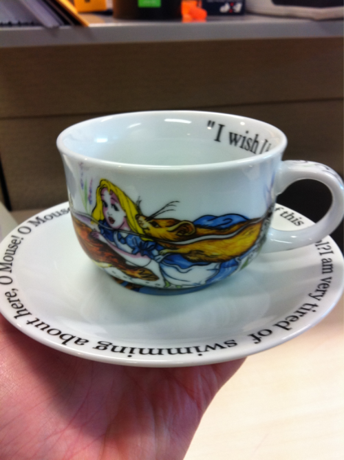My Alice in Wonderland tea cup and saucer always brightens my day in the office.