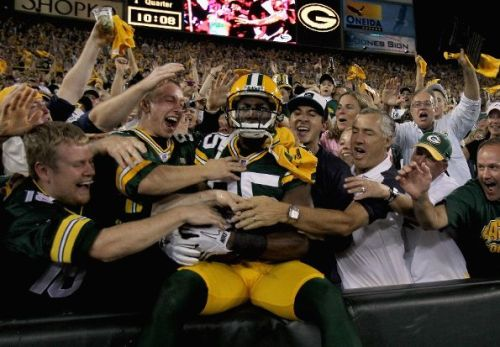 nfloffseason:  Ladies and gents, the first Lambeau Leap of the year honors belong to Greg Jennings. Welcome back NFL. (Photo by Jonathan Daniel/Getty Images)