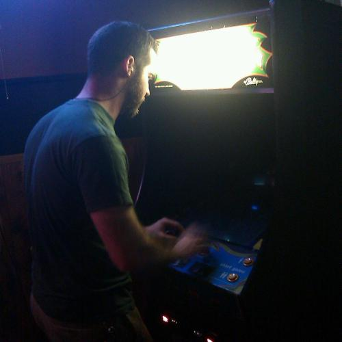 Brian showing a classic Galaga arcade who's boss. Burrow Bar in Jacksonville, FL.  New high score 193410.  -dominic