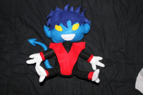 "Latest creation! Nightcrawler plush! I made him for me, but I decided to give him to my friend who got me into X-men in the first place since he was nerdgasming while I was making it.  While I was researching BAMF! because I'm also making a little word plush to go with him… I found this:  Plush versions of Nightcrawler, also called ""Bamfs"", had appeared in  many X-Men issues. Kitty Pryde, Illyana Rasputin, Jubilation Lee and Amanda Sefton,  among others, have been shown owning Bamf dolls. It is unknown whether Nightcrawler makes the dolls himself, whether he employs someone else to  make them for him, or whether some outside source makes them and he  merely purchases them.  So basically, mystery solved. I work for Nightcrawler and make his plushes. Whatup."