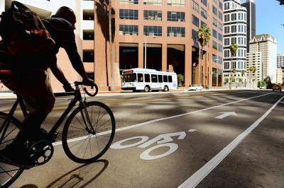 latimes:  In traffic-choked L.A., a car lane is given to bicycles:  City officials unveil a new 2.2-mile path stretching along 7th Street from Catalina Avenue in Koreatown to Figueroa Street downtown. All that was needed was paint, a few signs and some traffic light adjustments. Photo: A cyclist uses the new bike lane on 7th Street in downtown Los Angeles. The lane used to be for cars only. Credit: Wally Skalij / Los Angeles Times