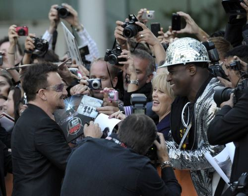 nationalpost:  Toronto International Film Festival U2's Bono signs autographs for fans at the gala presentation for the documentary film From The Sky Down at the 36th Toronto International Film Festival, Sept. 8, 2011. (Photo: Mike Cassese/Reuters)