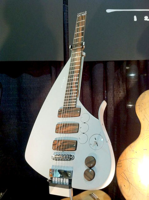 "Teuffel Tesla Prodigy 2001 While Gibson tries hard to appear on the forefront of innovation (with its painful and unconvincing Firebird X), others feel already at ease. Hard to believe this Teuffel guitar hosts an ultra compact 30"" scale."